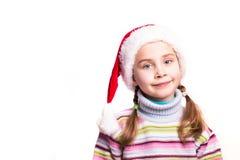 一个美丽的女孩的纵向圣诞老人的帽子的 库存照片