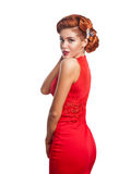 一个美丽的女孩的画象一件红色礼服的 图库摄影