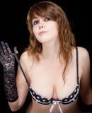一个美丽的女孩的画象女用贴身内衣裤的 免版税库存图片