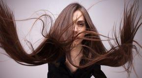 女孩画象有飞行头发的 免版税库存图片