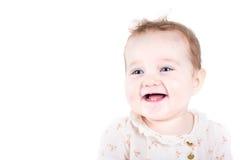 一个美丽的女婴的画象一件花卉衬衣的 库存照片
