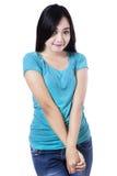 一个美丽的害羞的年轻亚裔女孩 免版税库存图片