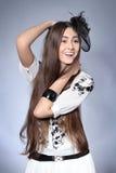 一个美丽的帽子的女孩 免版税库存照片
