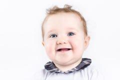一个美丽的微笑的女婴的画象 免版税库存照片