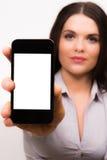 有iphone移动设备的美丽的年轻女商人 免版税库存图片