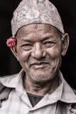 一个老人的画象有花的 库存照片