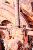 一个老古色古香的蒸汽路辗零件 免版税库存图片