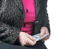 一个老妇人的手有美元的 库存照片