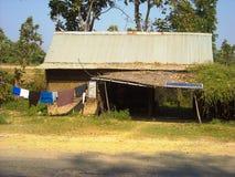 一个老房子在密林在缅甸 免版税库存图片