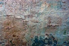一个老混凝土墙的色的纹理有镇压的 库存照片