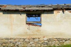 一个老被破坏的村庄的窗口 库存图片