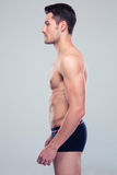 一个肌肉人的侧视图画象 库存图片