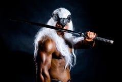 一个肌肉战士的纵向有剑的 库存图片