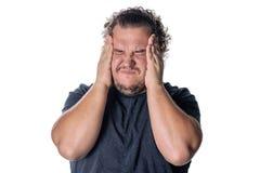 一个肥胖人有高血压和头疼 超重和健康问题 库存图片