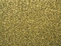 一个色的橡皮膏的金子纹理,样式,抽象背景,墙纸 免版税库存图片