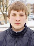 一个年轻人的画象夹克的 库存照片