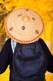 一个英俊的西班牙年轻人的画象在森林背景,后面看法中的戴一个亚洲圆锥形帽子 库存照片