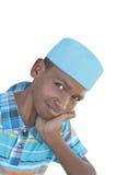 戴一个蓝色帽子的12岁的男孩,被隔绝 图库摄影