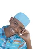 戴一个蓝色帽子的12岁的男孩,被隔绝 免版税库存照片