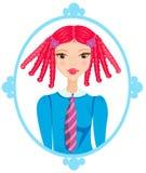 一个蓝色框架的红头发人女小学生 库存照片