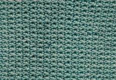 一个蓝色钩针编织补丁 库存图片