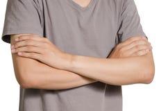 一个被交叉的亚洲年轻人双臂 库存图片