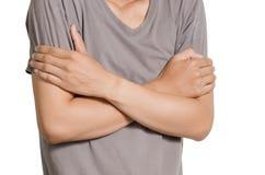 一个被交叉的亚洲年轻人双臂 库存照片
