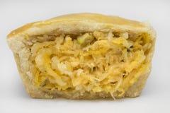 一个被切的传统巴西微型鸡饼叫empada关闭 图库摄影