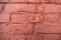 一个被绘的桃红色砖墙的纹理 免版税库存图片