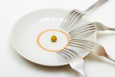 一个豌豆和许多叉子 库存照片