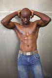 一个赤裸上身的肌肉人的画象 库存图片