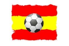 一个足球的一个美好的概念反对旗子背景的 免版税库存图片