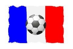 一个足球的一个美好的概念反对橄榄球背景的 免版税库存照片