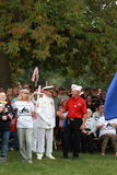 一个退伍军人招呼别的在救球我们的发怒集会,诺克斯维尔,衣阿华 免版税库存照片
