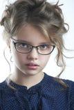 一个逗人喜爱的小女孩特写镜头的画象 图库摄影