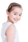 一个逗人喜爱的小女孩的特写镜头画象。 免版税库存图片