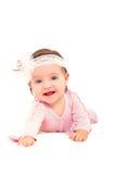 一个逗人喜爱的小女孩的画象有一个冠的在头 免版税库存照片