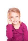 一个逗人喜爱的小女孩的画象有铅笔的在手中 免版税库存照片