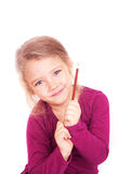 一个逗人喜爱的小女孩的画象有铅笔的在手中 库存照片