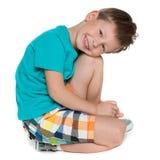一个逗人喜爱的小男孩的画象 库存照片