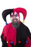 一个邪恶的小丑的画象,白色的 库存照片