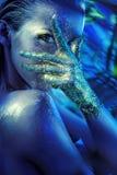 一个闪烁的金黄夫人的概念性画象 库存照片