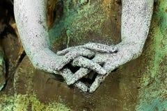 一个雕象的手与但愿的 免版税库存照片
