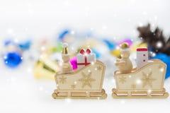 一个雪橇的圣诞老人与礼物和袜子 图库摄影
