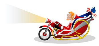 一个雪橇的现代圣诞老人以摩托车的形式 免版税图库摄影