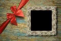 一个鞋带葡萄酒空的照片框架 免版税库存照片
