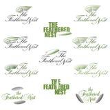 一个风格化商标或标志用羽毛装饰的巢的 库存图片