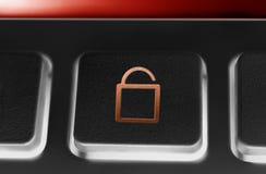 一个黑按钮的宏指令有红色被打开的安全锁象和背后照明的 免版税图库摄影
