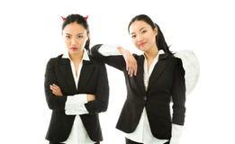 一个年轻亚洲人的天使和恶魔边 免版税图库摄影