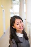 一个年轻亚洲女学生的画象在大学 免版税图库摄影
